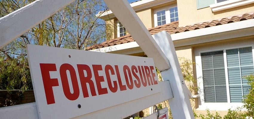 How long do you need to wait to buy a home after a foreclosure?
